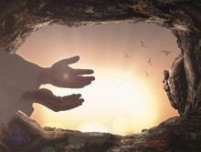 Ascension Day Concept: The Scars In The Hands Of Jesus Christ Over Tombstone Sunrise Background