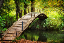 Wooden Bridge Accross The Rive...