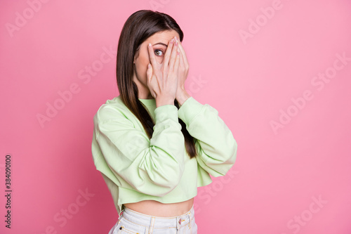 Obraz Photo of attractive funny lady closing eyes arms peeking glance wanna know secret curious person wear casual green crop sweatshirt pullover isolated pink pastel color background - fototapety do salonu