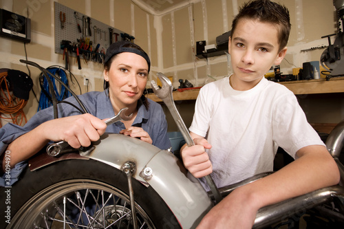 Hispanic woman and boy in garage