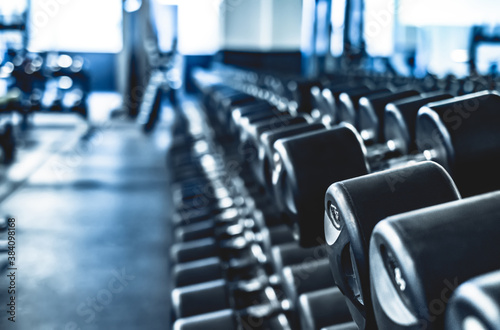 Obraz dumbbells in modern athletic gym - fototapety do salonu