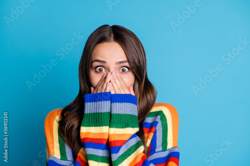 Obraz Close up photo of astonished girl impressed wonderful novelty close cover hands mouth wear good look winter season outfit isolated over blue color background - fototapety do salonu