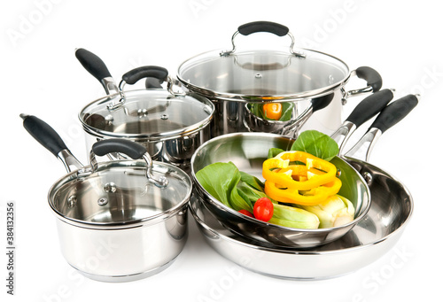 Carta da parati Stainless steel pots and pans with vegetables