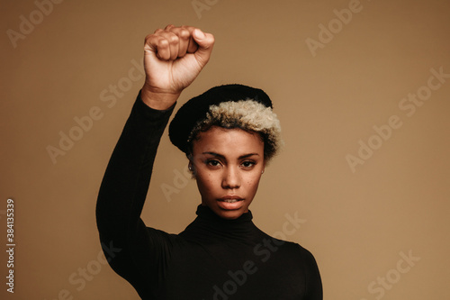 Fotografering Close up of african american woman with raised fist