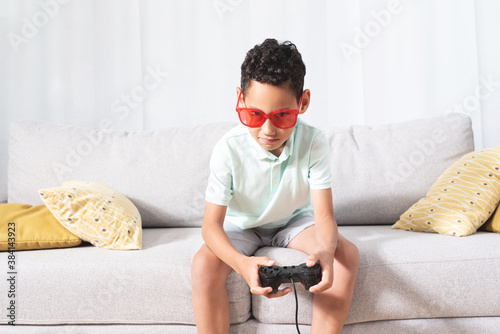 Fototapeta Boy playing video game at home obraz