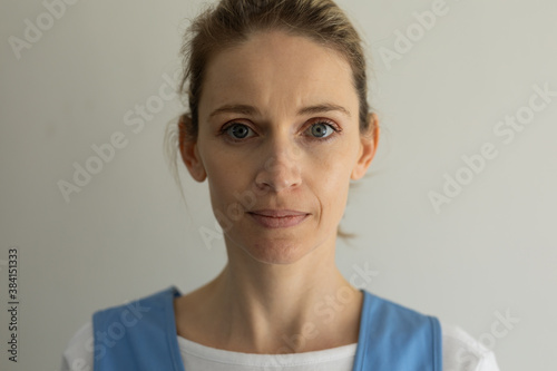 Portrait of female health worker against white background