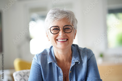 Obraz portrait of a beautiful smiling 55 year old woman with white hair - fototapety do salonu