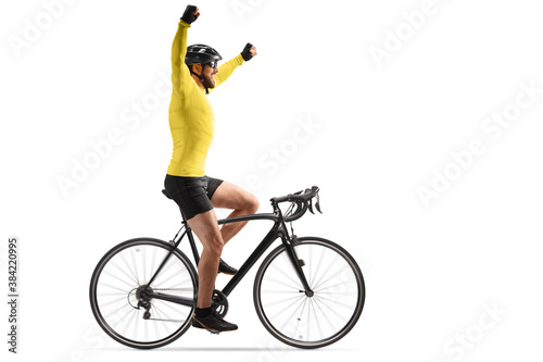Tableau sur Toile Profile shot of a male cyclist with a helmet riding a road bicycle and spreading