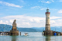Harbor Entrance At Lake Constance, Lindau, Germany. Beautiful Landscape With Lion Statue And Lighthouse.