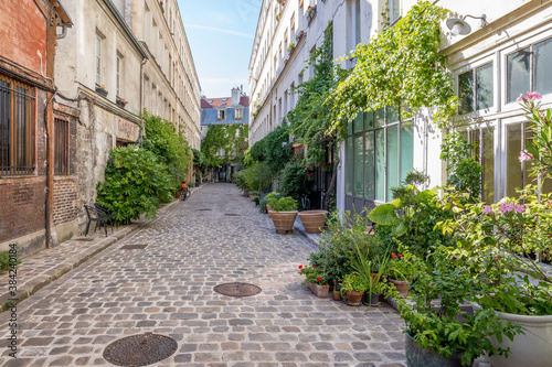 Photographie Paris, France - June 24, 2020: Passage Lhomme, one of the romantic courtyards in the East of Paris, France