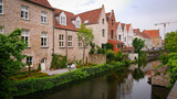 Fototapeta Londyn - Beautiful View Of Authentic Houses Above The Canal In The Belgian City Of Bruges.