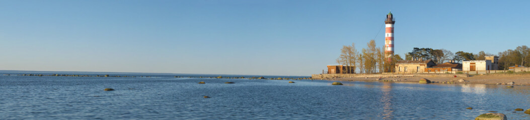 Panorama of the Gulf of Finland with Shepelevsky lighthouse on a sunny May evening. Leningrad region, Russia