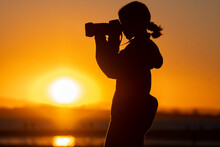 Young Photographer At Sunset