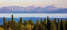 Panoramic View Of Corfu Island, Mountains And Sea With Cypress And Olive Trees