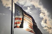 The American Flag On A Flag Po...