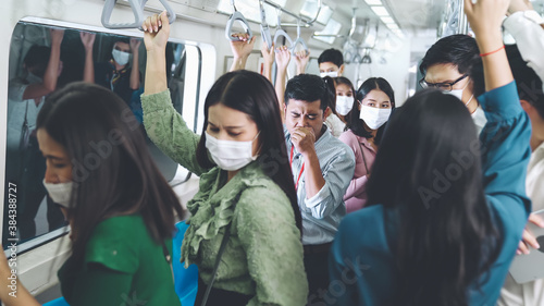 Fototapeta Sick man on train cough and make other people feel worry about virus spreading . Coronavirus COVID 19 pandemic and public transportation trouble concept . obraz