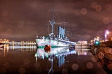 Saint Petersburg, Russia. Russian Cruiser Aurora - Russian Cruiser, Night Photography, Famous Landmark, Now It Is A Museum Ship