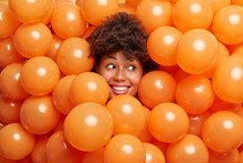 Cheerful Curly Haired Ethnic W...