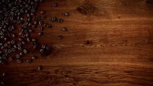 Coffee Beans On Wood Oak Backg...