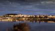 Vista panorámica de la ciudad de Badajoz sobre el río Guadiana al atardecer.