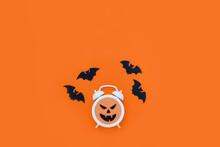 White Alarm Clock With Evil Fa...