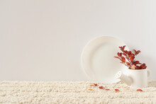 White Plate And Jug. Twig With...