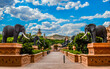 canvas print picture - Entrance of The Palace / Lost City /Sun City with stone statues under blue and cloudy sky