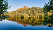 Known In Gaelic As Sgorr Na Ciche, The Pap Of Glencoe Is A Familiar Landmark Around The Lower End Of The Glen And Loch Leven. Seen Here With Beautiful Reflections In The Water