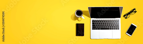 Obraz Laptop computer with a smartphone and office objects - fototapety do salonu