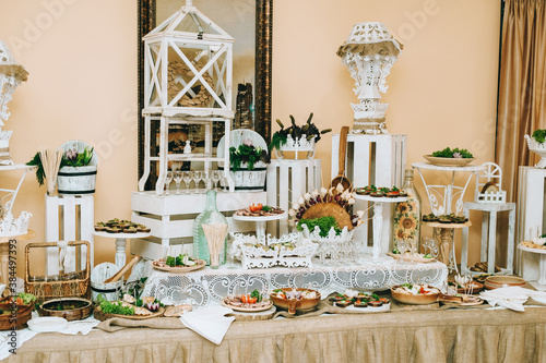 Fototapeta Beautifully decorated catering banquet table with different food snacks and appetizers