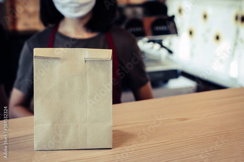 waitress wearing protection face with dessert paper set bag on counter bar waiti Canvas