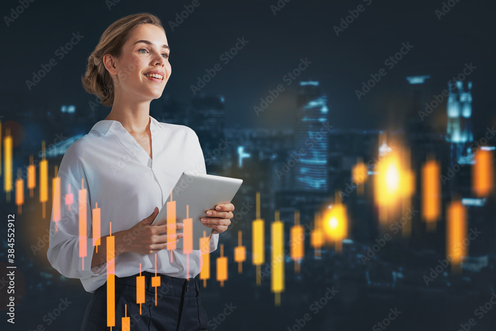 Fototapeta Smiling woman with tablet in night city, financial chart