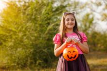 Girl Wearing Halloween Costume...