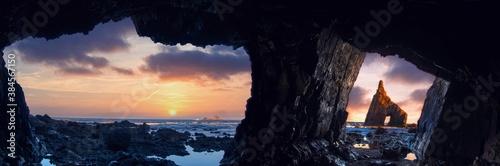 Obraz Sunrise from inside the cave of Campiecho in Asturias, Spain. - fototapety do salonu