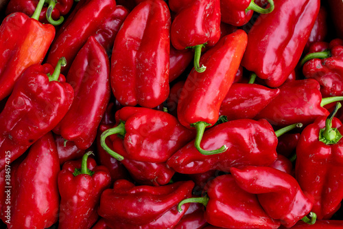 Close up of fresh organic red paprika on a market stall Canvas