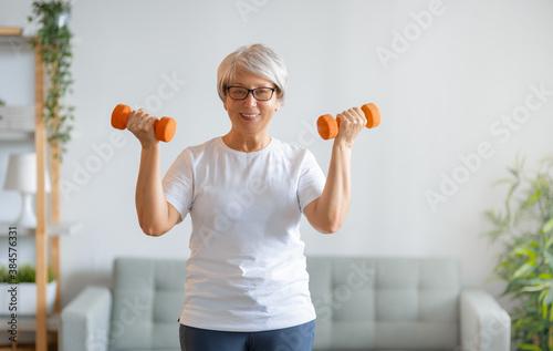 Fototapeta Senior woman exercising at home. obraz