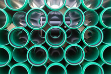 Side View Of A Stack Of Plastic Pipes For Road Constructions