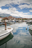 Boats and boats in the port against the backdrop of the city and mountains, Tivat, Montenegro.