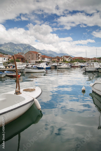 Fototapeta Boats and boats in the port against the backdrop of the city and mountains, Tivat, Montenegro. obraz