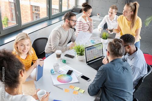 Fototapeta Young creative business people meeting at office. obraz na płótnie