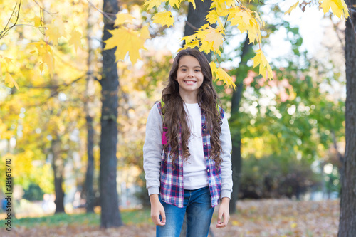 Fotomural happy girl in casual style spend time walking in autumn park enjoying good weath