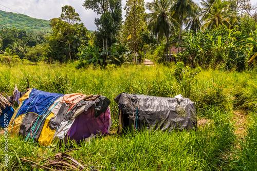 Basic accommodation next to the Kandy to Columbo mainline railway in Sri Lanka, Canvas Print