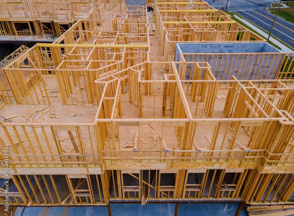 Fototapeta Wooden construction new residential home beam framing
