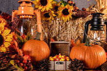 Fall Still Life With Pumpkins Sunflowers Bale Of Straw Lanterns And Box Of Candy Corn
