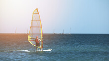 Recreational Water Sports. Windsurfing. Windsurfer Surfing The Wind On Waves In Ocean, Sea. High Quality Photo