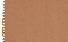 Closeup Torn Brown Paper On Gr...