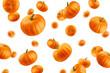 Leinwandbild Motiv Falling Pumpkin isolated on white background, selective focus