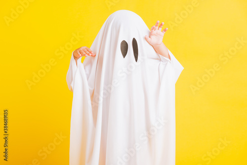 Photo Funny Halloween Kid Concept, Closeup a little cute child with white dressed cost