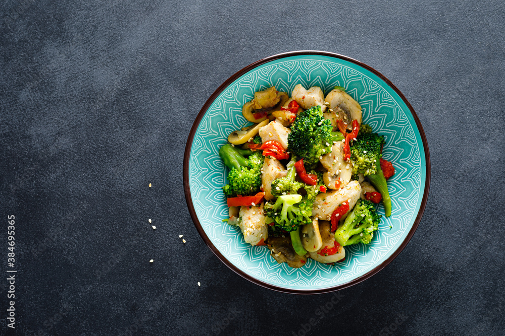 Fototapeta Chicken stir fry with vegetables and mushrooms
