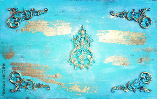 background of blue and gold wooden vintage wall with floral emboss details